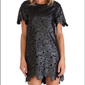 J.O.A black laser cut faux leather dress